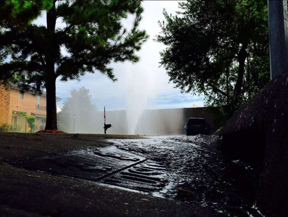 A nearly 30-foot geyser of water could seen as it shot up from an apparent water line break about 10:30 a.m. Tuesday, Aug. 30, 2016, in the 12000 block of Wembley Drive near Beltway 8 and Bellfort. (Mark Mulligan/Houston Chronicle)