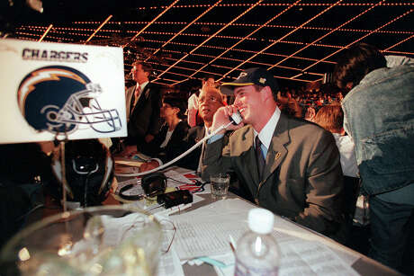 FILE — Ryan Leaf talks on the phone after being selected by the San Diego Chargers second overall in the 1998 NFL draft, just behind Peyton Manning, in New York, April 18, 1998. Despite their vastly dissimilar careers, Manning and Leaf remain paired in many fans minds to this day. A similar fate could await Jared Goff and Carson Wentz in the 2016 draft. (Chang W. Lee/The New York Times)