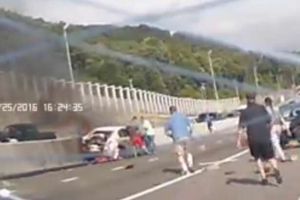 Citizens saved a woman from a burning car after a 10-car pileup trapped her in the vehicle Monday Aug. 29, 2016.