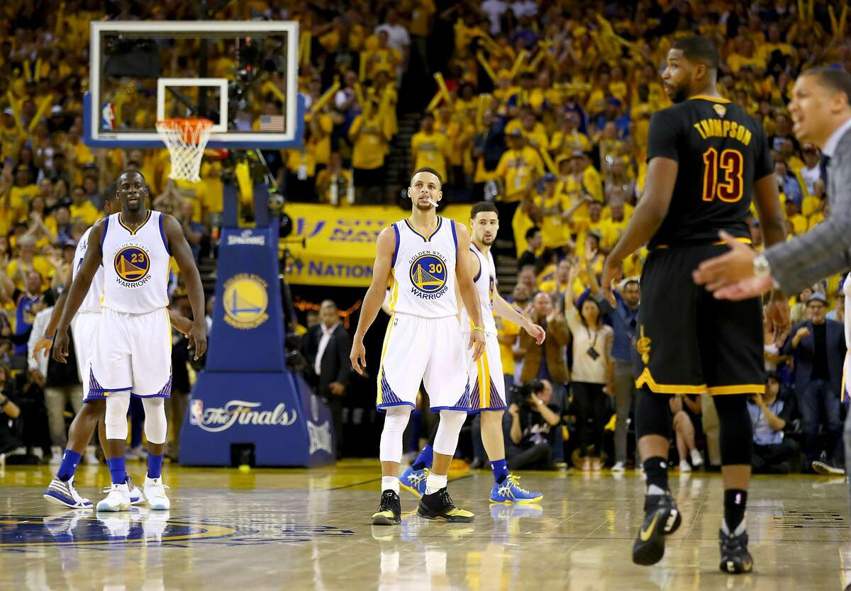 OAKLAND, CA - JUNE 19: Draymond Green #23, Stephen Curry #30 and Klay Thompson #11 of the Golden State Warriors stand on the court in Game 7 of the 2016 NBA Finals at ORACLE Arena on June 19, 2016 in Oakland, California. NOTE TO USER: User expressly acknowledges and agrees that, by downloading and or using this photograph, User is consenting to the terms and conditions of the Getty Images License Agreement. (Photo by Ezra Shaw/Getty Images)