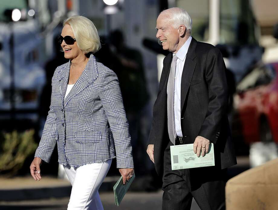 U.S. Sen. John McCain, R-Ariz., and his wife, Cindy McCain, arrive to vote at a polling station, Tuesday, Aug. 30, 2016, in Phoenix. McCain is seeking the republican nomination in Arizona's primary election. (AP Photo/Matt York) Photo: Matt York, Associated Press