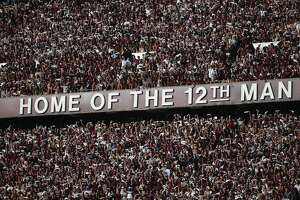 COLLEGE STATION, TX - SEPTEMBER 12:  Fans of the Texas A&M Aggies cheer in the stands before the start of their game against the Ball State Cardinals at Kyle Field on September 12, 2015 in College Station, Texas.  (Photo by Scott Halleran/Getty Images)