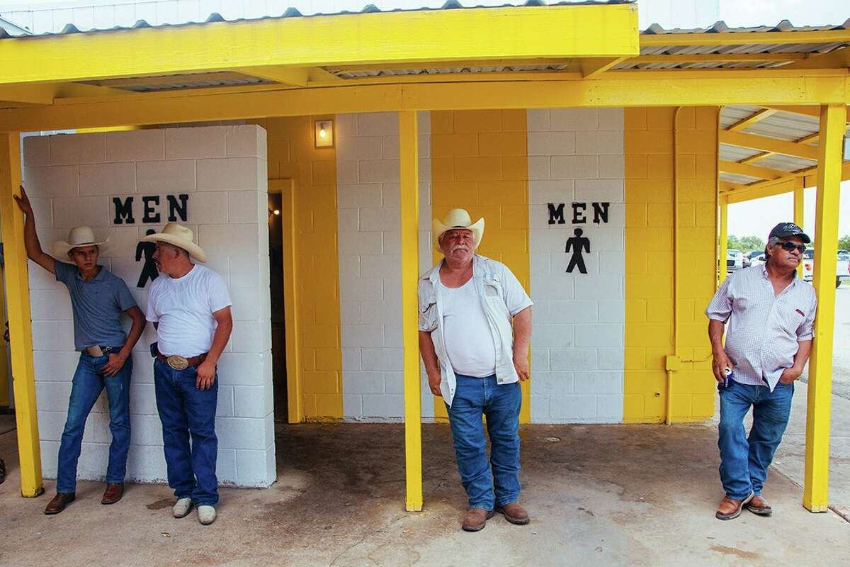 """""""Men o hombres"""" is one of the images by photographer Arlene Mejorado featured in """"Califas Lens, San Antonio Heart: Outside Looking In,"""" an exhibit at R Space of images taken at Poteet's flea market. The show is part of Fotoseptiembre USA."""