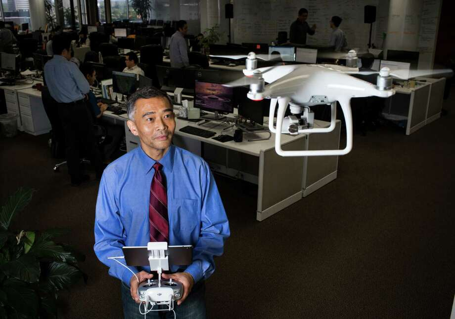 Panton Inc. CEO and President Frank Li takes a look at a drone during a portrait session at the Panton Inc. offices in Houston, Wednesday, Aug. 24, 2016. The company combined with emerging technologies builds search-oriented information system platforms for the benefits of their clients. ( Marie D. De Jesus / Houston Chronicle ) Photo: Marie D. De Jesus, Staff / © 2016 Houston Chronicle