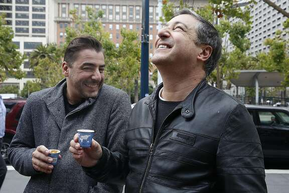 Chefs Jordi Roca (left) and  Joan Roca (right) of El Cellar de Can Roca in Spain have a Four Barrel expresso at the farmer's market in front of the ferry building on Thursday, August 25, 2016, in San Francisco, Calif.