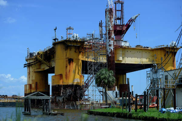 A 40-year-old man fell off the Sovereign Explorer drilling rig in Sabine Pass while working on it Tuesday morning. Port Arthur Fire Department divers were on scene searching the water.  Photo taken Tuesday 8/30/16 Ryan Pelham/The Enterprise