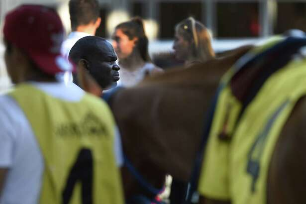 Trainer Charlton Baker keeps a close eye on his charge Ecliptical Jake in the 10th race at the Saratoga Race Course August 29, 2016 in Saratoga Springs, N.Y.   (Skip Dickstein / Times Union)