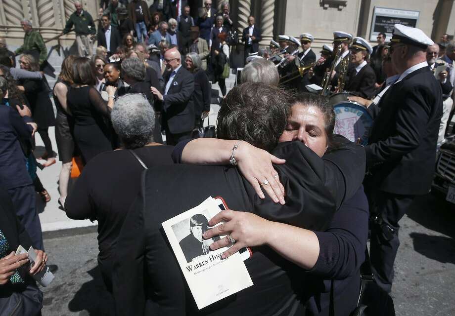 Mourners hug outside Saints Peter and Paul Church after a funeral mass was held for longtime journalist Warren Hinckle in San Francisco, Calif. on Aug. 30, 2016. Photo: Paul Chinn, The Chronicle