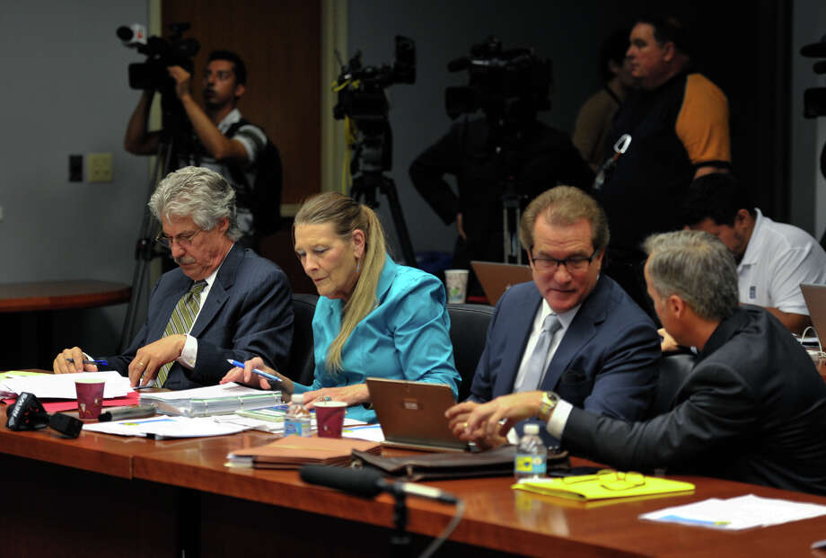 This file photo shows city negotiators Jeff Londa (left), Bettye Lynn (2nd left) , Michael Bernard (2nd right) and Buddy Morris (right) looking over a contract proposal from the San Antonio Police Officers Association. The mediated agreement isn't perfect, but it is good enough. Photo: Robin Jerstad /San Antonio Express-News