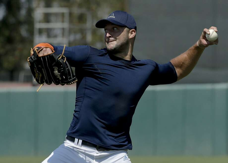 Former NFL quarterback, Tim Tebow throws a ball for baseball scouts and the media during a showcase on the campus of the University of Southern California, Tuesday, Aug. 30, 2016 in Los Angeles. The Heisman Trophy winner works out for a big gathering of scouts on USC's campus in an attempt to start a career in a sport he hasn't played regularly since high school. (AP Photo/Chris Carlson) Photo: Chris Carlson, Associated Press
