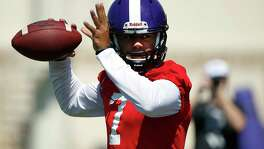 TCU quarterback Kenny Hill throws during a team drill at practice on Aug. 5, 2016, in Fort Worth.