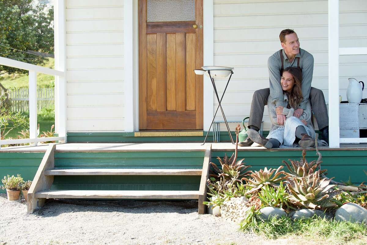 """This image released by DreamWorks II Distribution Co., LLC., shows Michael Fassbender as Tom Sherbourne and Alicia Vikander as his wife Isabel in a scene from """"The Light Between Oceans,� based on the acclaimed novel by M.L. Stedman. (Davi Russo/DreamWorks II Distribution Co., LLC. via AP)"""