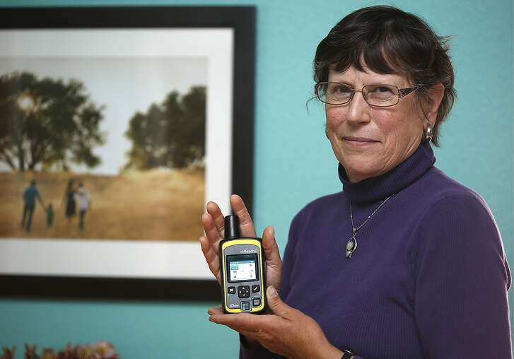 Tara Steele at home on Thursday, August 25, 2016, in Santa Rosa, Calif.  She was hiking in the Sierra earlier this month when she realized she was having a stroke and sent an SOS signal on the inReach SE Global Satellite Communicator from DeLorme she is holding.