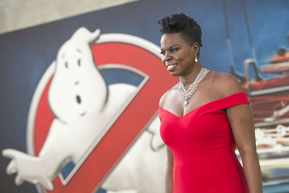 "(FILES) This file photo taken on July 08, 2016 shows actress Leslie Jones attends the Los Angeles Premiere of ""Ghostbusters"" in Hollywood, California. ""Ghostbusters"" star Leslie Jones says she has left Twitter because of ""sickening"" cyberbullies who were racially abusing her on the social network. Jones, who is African American, was inundated by disturbing tweets over the weekend containing racial slurs, accusing her of being ugly and likening her to the recently-slain Cincinnati Zoo gorilla Harambe. ""I leave Twitter tonight with tears and a very sad heart. All this cause I did a movie. You can hate the movie but the shit I got today...wrong,"" the Saturday Night Live comedian and actress said late July 18, 2016.  / AFP PHOTO / VALERIE MACONVALERIE MACON/AFP/Getty Images Photo: VALERIE MACON, AFP/Getty Images"