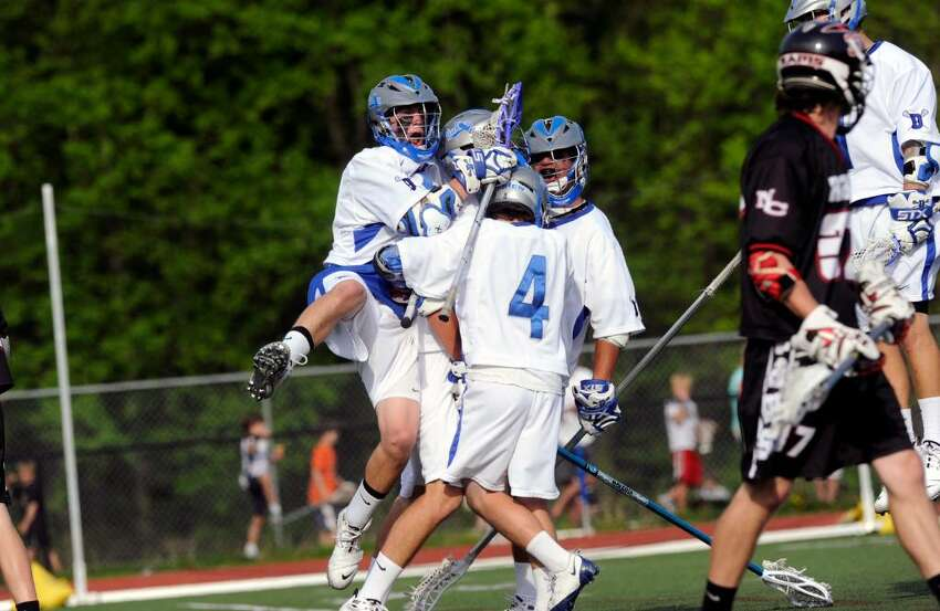 Darien boys lacrosse team reacts to one of many goals as Darien High School hosts New Canaan High in a boys lacrosse game Saturday, May 1, 2010. Darien won 11-5.