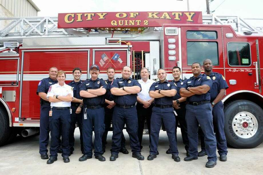 Staff members from the Katy Fire Department stand in front of their fire engines on Friday, Aug. 26, 2016. Photo: Craig Mosely\Houston Chronicle
