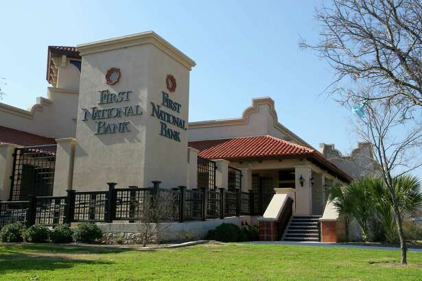 A former First National Bank branch in San Antonio is shown in this January 2013 photo. Former bank officers and directors have agreed to collectively pay $1.5 million to settle claims made by the Federal Deposit Insurance Corp.