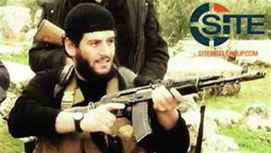 "This undated militant image provided by SITE Intel Group shows Abu Muhammed al-Adnani, the Islamic State militant group's spokesman who IS say was ""martyred"" in northern Syria. The IS-run Aamaq news agency said Tuesday, Aug. 30, 2016 that al-Adnani was ""martyred while surveying the operations to repel the military campaigns against Aleppo,"" without providing further details. (SITE Intel Group via AP) Photo: HONS / SITE Intel Group"