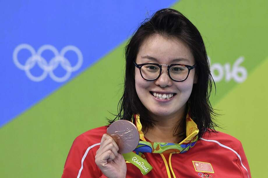 Japan's Fu Yuanhui poses with her bronze medal on the podium of the Women's 100m Backstroke during the swimming event at the Rio 2016 Olympic Games at the Olympic Aquatics Stadium in Rio de Janeiro on August 8, 2016.   / AFP PHOTO / GABRIEL BOUYSGABRIEL BOUYS/AFP/Getty Images Photo: GABRIEL BOUYS, Staff / AFP or licensors