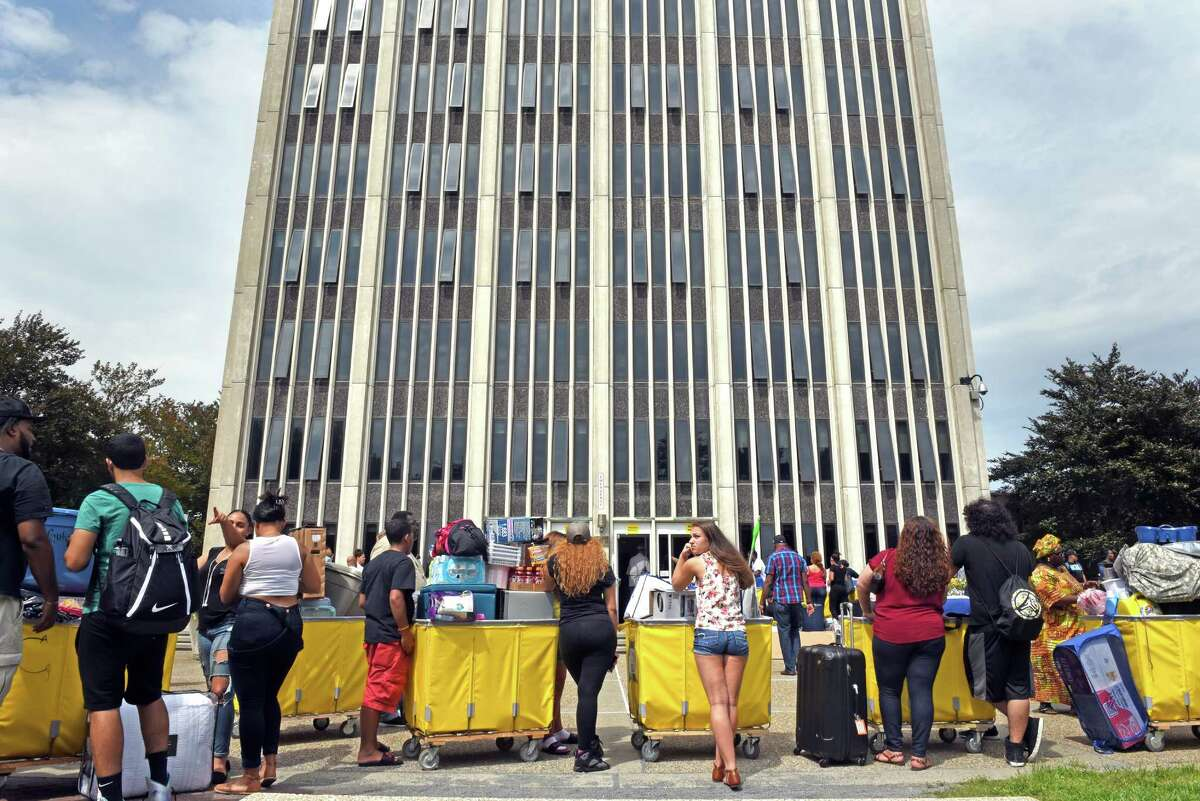 Families and friends help students with their belongings during the University at Albany's student move-in day at State Quad on Thursday, Aug. 25, 2016, in Albany, N.Y. (Michael P. Farrell/Times Union)