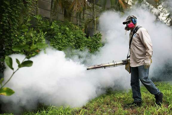 Carlos Varas, a Miami-Dade County mosquito control inspector, uses a Golden Eagle blower to spray pesticide to kill mosquitos in the Miami Beach neighborhood as the county fights to control the Zika virus outbreak on Aug. 24, 2016 in Miami Beach, Florida. (Photo by Joe Raedle/Getty Images)