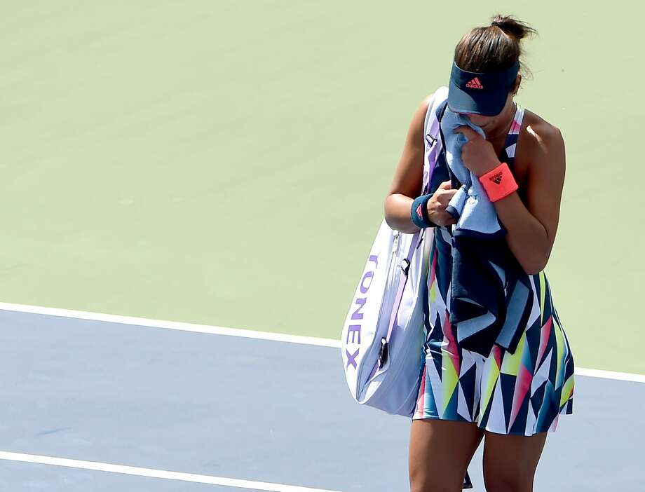 Ana Ivanovic departs after falling to Denisa Allertova in straight sets. Ivanovic had seven double-faults and 41 unforced errors en route to her second straight U.S. Open first-round loss. Photo: TIMOTHY A. CLARY, AFP/Getty Images