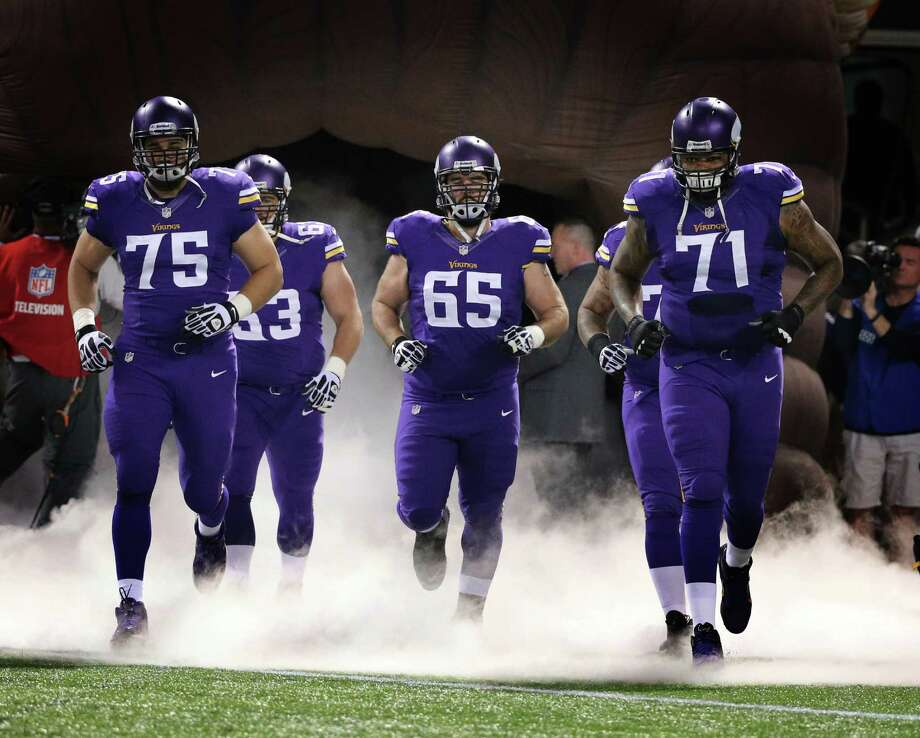 MINNEAPOLIS, MN - OCTOBER 27: John Sullivan #65, Matt Kalil #75 and Phil Loadholt #71 of the Minnesota Vikings enter the field during an NFL game against the Green Bay Packers at Mall of America Field at the Hubert H. Humphrey Metrodome on October 27, 2013 in Minneapolis, Minnesota.  (Photo by Tom Dahlin/Getty Images) Photo: Tom Dahlin / Getty Images / 2013 Tom Dahlin