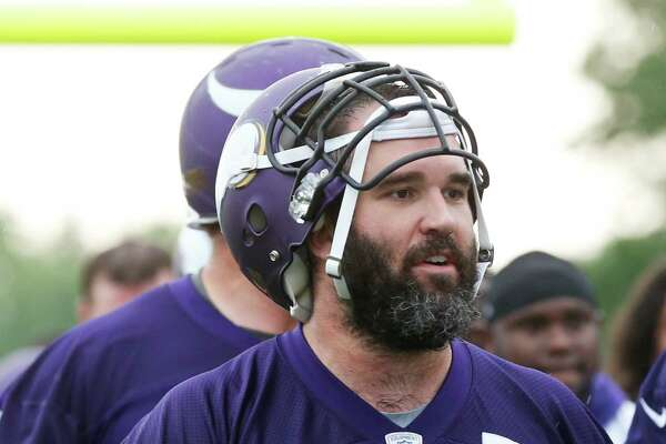 Minnesota Vikings center John Sullivan, who missed the entire season with a back injury, heads to the locker room after practice in the NFL football team's minicamp Tuesday, June 14, 2016, in Eden Prairie, Minn. (AP Photo/Jim Mone)