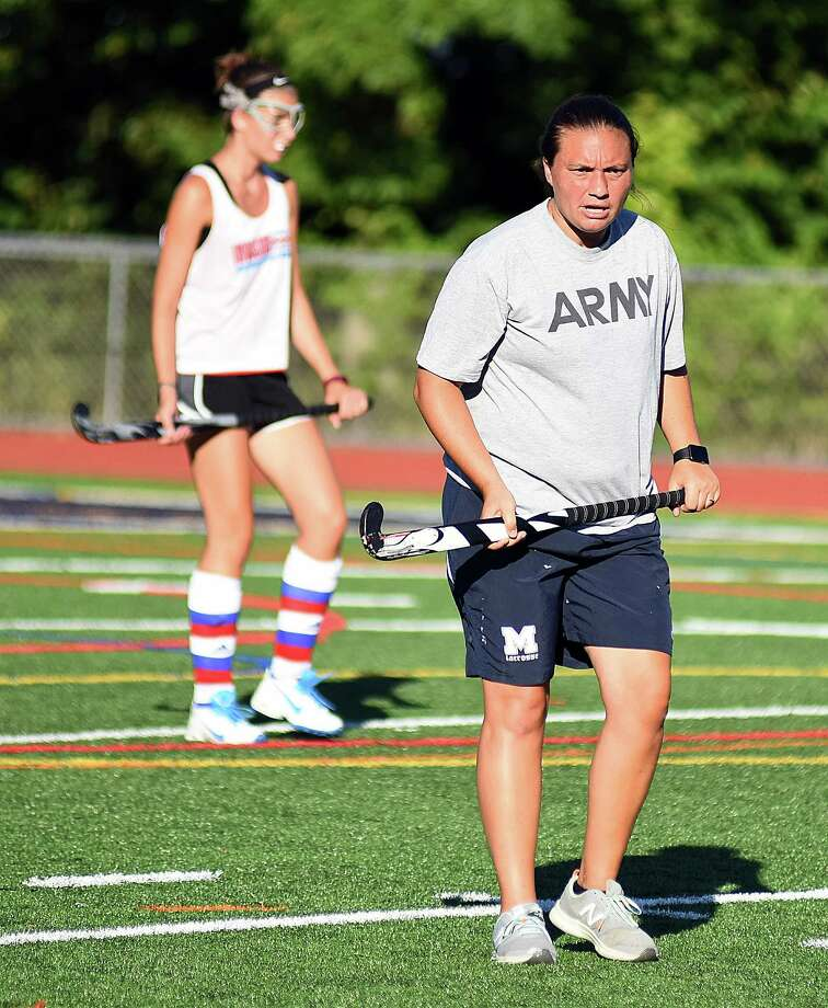 Brien McMahon coach Dani Brown, right, has put away her softball coaching whistle in place of a field hockey one after taking over the Senators fall program this summer. Photo: John Nash / Hearst Connecticut Media / Norwalk Hour