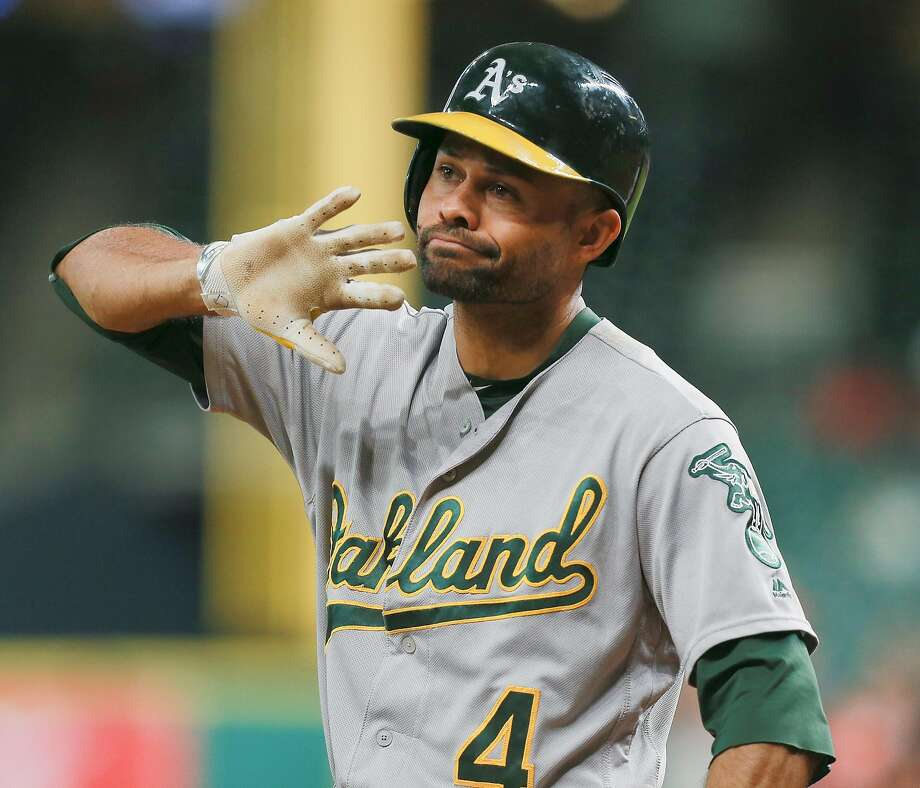 HOUSTON, TX - AUGUST 29:  Coco Crisp #4 of the Oakland Athletics disagrees with the third base umpires decision that he didn't check his swing for strike three in the first inning against the Houston Astros at Minute Maid Park on August 29, 2016 in Houston, Texas.  (Photo by Bob Levey/Getty Images) Photo: Bob Levey, Getty Images