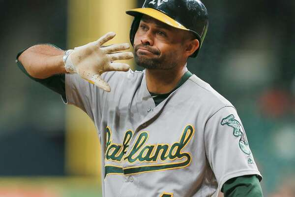 HOUSTON, TX - AUGUST 29:  Coco Crisp #4 of the Oakland Athletics disagrees with the third base umpires decision that he didn't check his swing for strike three in the first inning against the Houston Astros at Minute Maid Park on August 29, 2016 in Houston, Texas.  (Photo by Bob Levey/Getty Images)