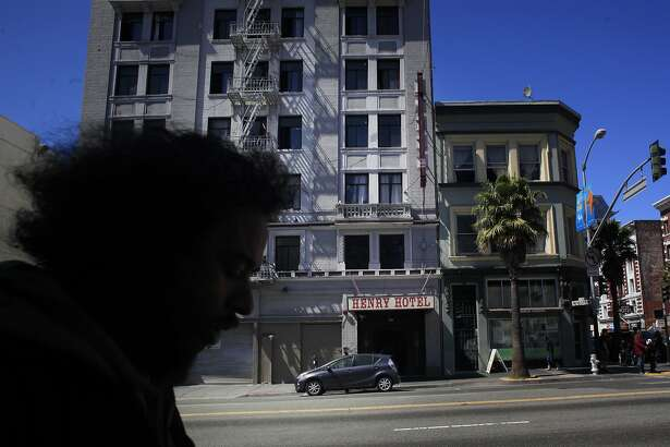 The Henry Hotel, a privately run SRO, towers above the 6th Street corridor in San Francisco's South of Market/Tenderloin district.