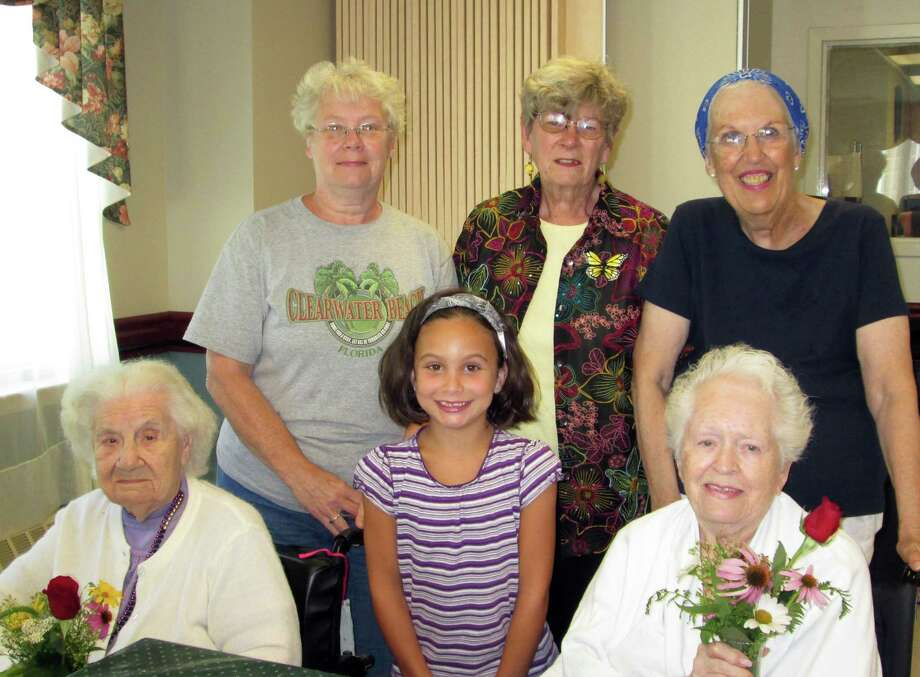 On Aug. 19, the Center for Nursing and Rehabilitation at Hoosick Falls presented a flower arranging seminar for its residents. Bea Peterson, Carol Gatus, Barb Wrubleski presented the seminar using their flowers. Peterson lives in Hoosick Falls and has been active in the garden scene.  Her kudos include; a 43 year member and past National President of the Women's National Farm and Garden Association and a flower show judge. Gatus is a master gardener with Cornell Cooperative Extension and an auxiliary volunteer, and Barb Wrubleski is an auxiliary volunteer. Pictured on bottom row from left to right is: Annie Yurewitch, Gianna Shea, Betty Peer, top row is Wrubleski, Gatus and Peterson.  (Christa Caron)