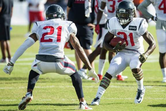 A.J. Bouye (21) and  Charles James (31) make cornerback one of the Texans' deepest positions.