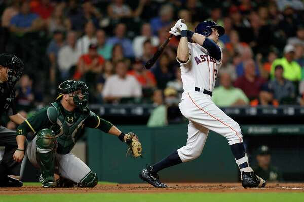 Houston Astros left fielder Colby Rasmus (28) watches his ball leave the park for a home run during the second inning of an MLB game at Minute Maid Park, Tuesday, Aug. 30, 2016 in Houston.