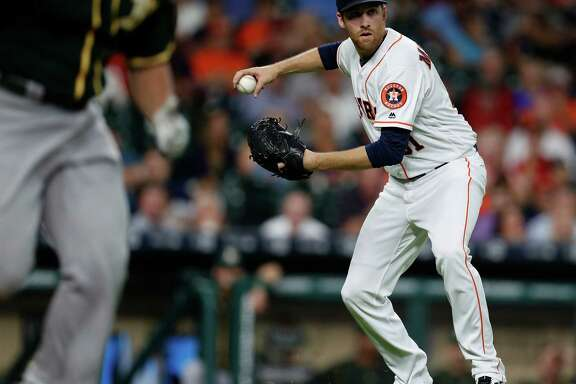 Houston Astros starting pitcher Collin McHugh (31) makes the throw to first as Oakland Athletics Yonder Alonso ground out during the second inning of an MLB game at Minute Maid Park, Tuesday, Aug. 30, 2016 in Houston.