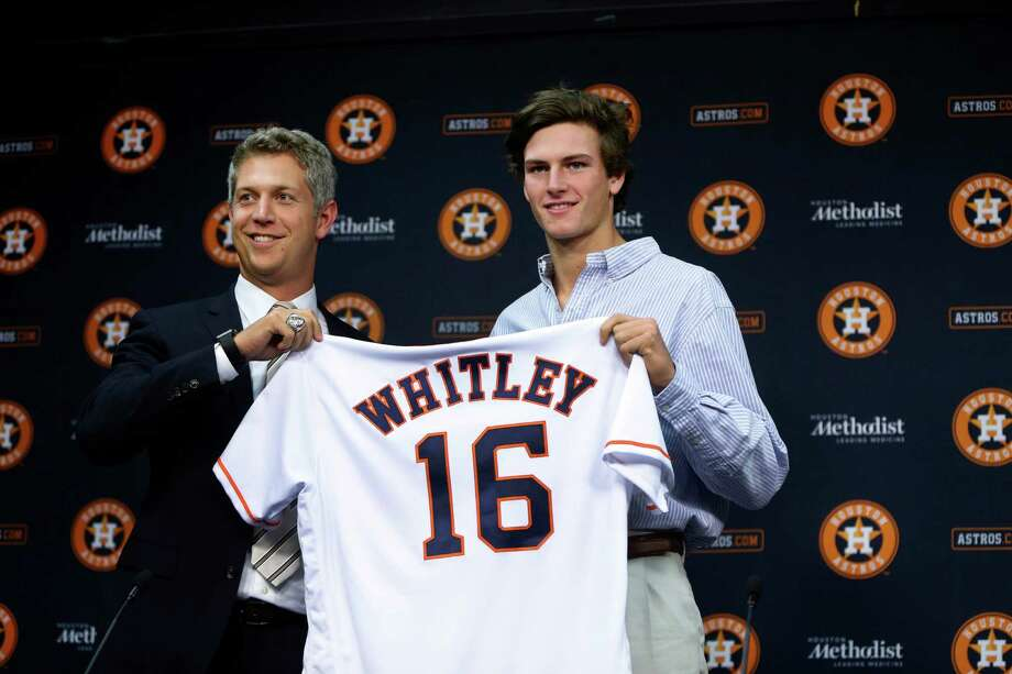 Forrest Whitley, who was selected with the 17th overall pick in the first round of the 2016 MLB First Year Player Draft, was introduced to the media by Astros Director of Amateur Scouting Mike Elias during a press conference after signing with the Astros, before the start of an MLB baseball game at Minute Maid Park, Wednesday, June 22, 2016, in Houston. ( Karen Warren  / Houston Chronicle ) Photo: Karen Warren, Staff / © 2016 Houston Chronicle