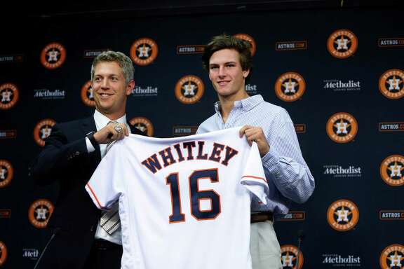 Forrest Whitley, who was selected with the 17th overall pick in the first round of the 2016 MLB First Year Player Draft, was introduced to the media by Astros Director of Amateur Scouting Mike Elias during a press conference after signing with the Astros, before the start of an MLB baseball game at Minute Maid Park, Wednesday, June 22, 2016, in Houston. ( Karen Warren  / Houston Chronicle )