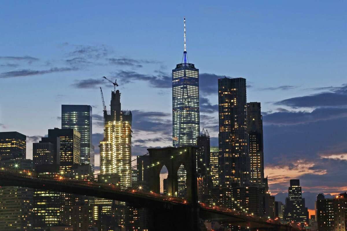 In this Aug. 19, 2016 photo, the lower Manhattan skyline, including One World Trade Center and the Brooklyn Bridge, are shown in New York. (AP Photo/Mark Lennihan) ORG XMIT: NYLS211