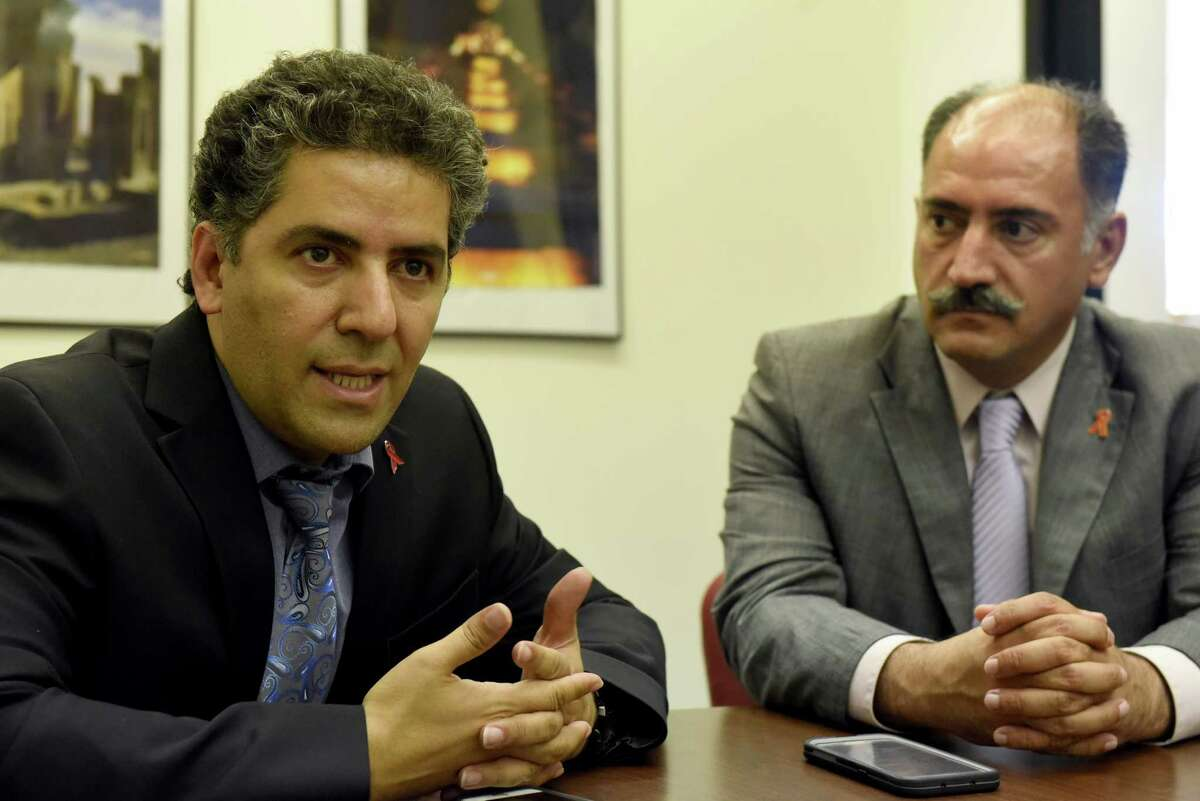 Brothers Dr. Kamiar and Dr. Arash Alaei of the Global Institute for Health & Human Rights at UAlbany on Friday Aug. 26, 2016 in Albany, N.Y. (Michael P. Farrell/Times Union)