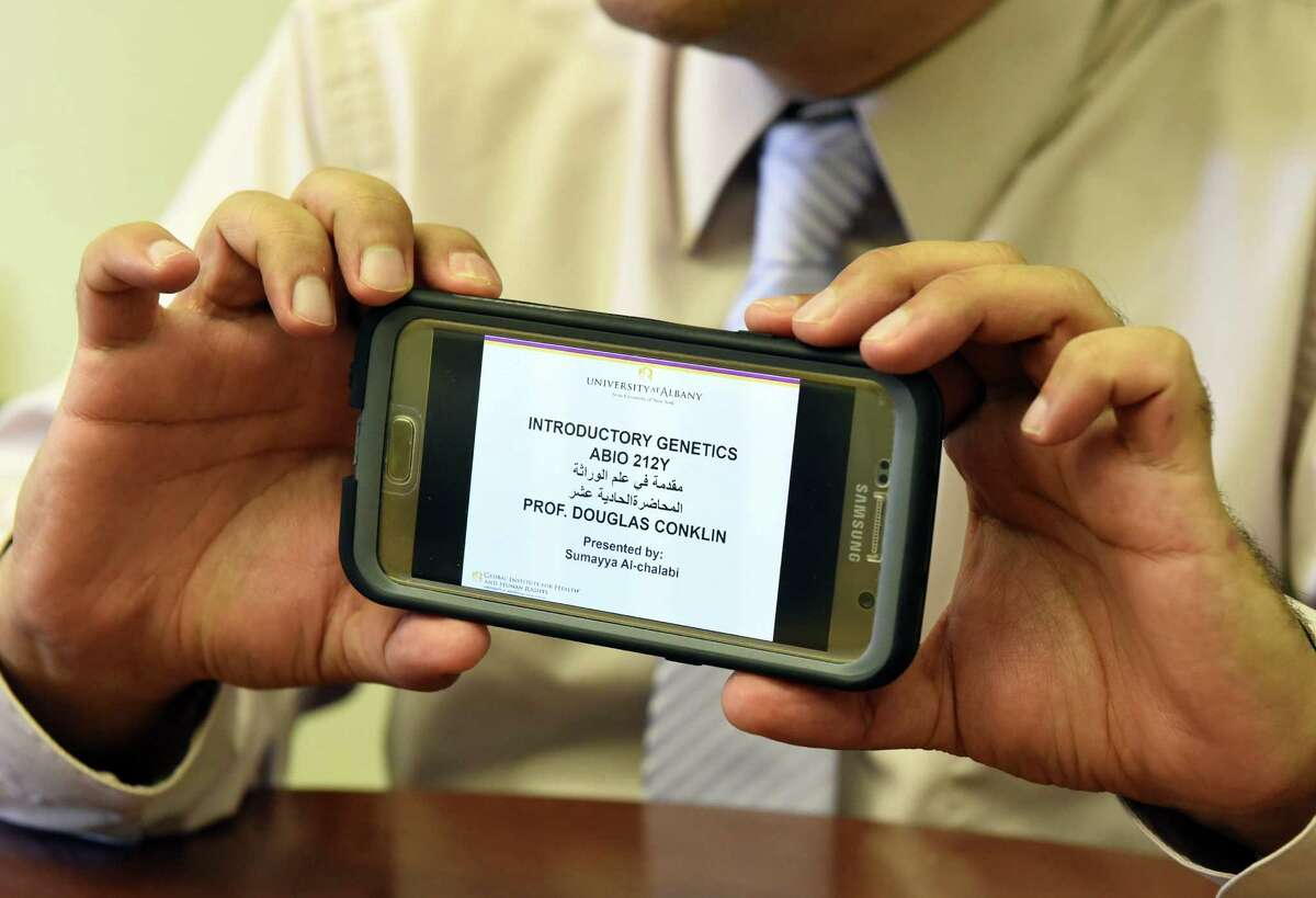 Dr. Arash Alaei of the Global Institute for Health & Human Rights holds a smart phone with app displayed for online courses for displaced Syrian refugees at UAlbany on Friday Aug. 26, 2016 in Albany, N.Y. (Michael P. Farrell/Times Union)