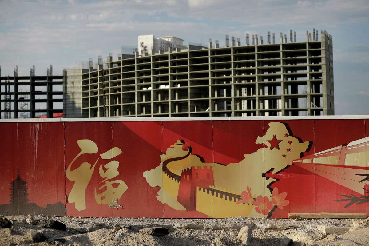 A wall with symbols of China partially blocks the view of the Resorts World property in Las Vegas. The Asian-themed casino property is projected to open in 2019.