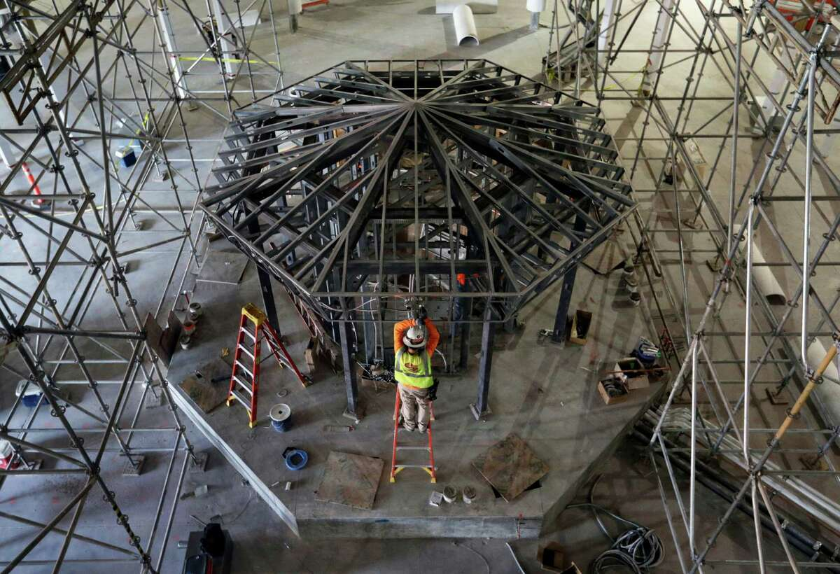In this Friday, Aug. 26, 2016, photo, construction continues on what will be the casino area at the Lucky Dragon Hotel and Casino in Las Vegas. Lucky Dragon executives said the new casino, projected to open in fall 2016, will focus on domestic Chinese gamblers. (AP Photo/John Locher)