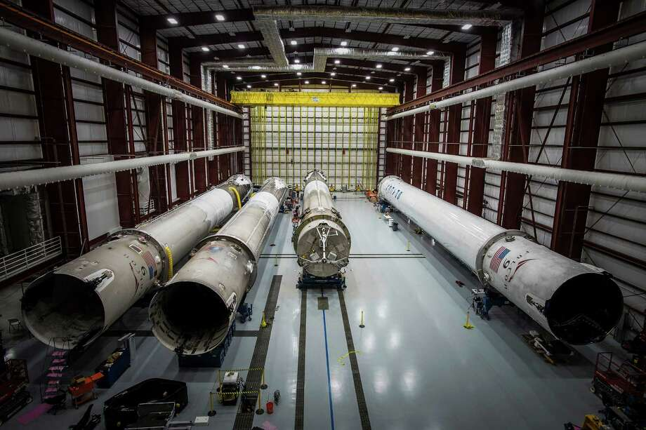 This June 6, 2016 photo made available by SpaceX shows recovered Falcon rocket boosters in a hangar at the Kennedy Space Center on Merritt Island, Fla. The company says it can save considerable time and money by reusing the big, expensive parts. (SpaceX via AP) Photo: HONS / SpaceX