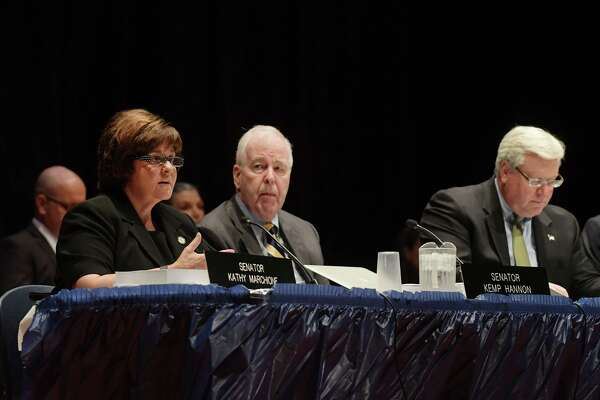 New York State Senator Kathy Marchione addresses those gathered as Senators Kemp Hannon, center, and Senator Thomas O'Mara also take part in the New York State Senate Joint Public Hearing in Hoosick Falls, on Tuesday, Aug. 30, 2016, at Hoosick Falls High School in Hoosick Falls, N.Y.  The hearing was held to hear from people about the water contamination in and around Hoosick Falls.  (Paul Buckowski / Times Union)