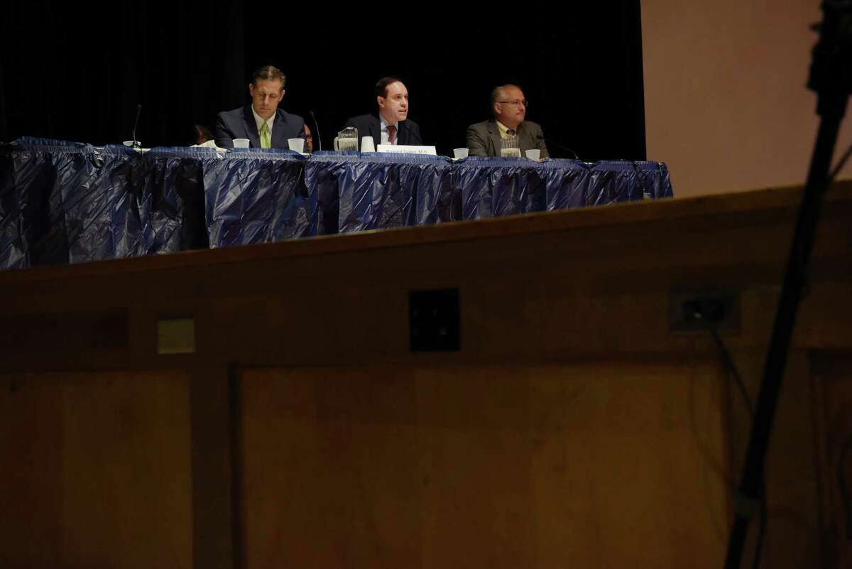 Doctor Howard Zucker, center, commissioner of the New York State Department of Health, testifies before the New York State Senate Joint Public Hearing in Hoosick Falls, on Tuesday, Aug. 30, 2016, at Hoosick Falls High School in Hoosick Falls, N.Y. The hearing was held to hear from people about the water contamination in and around Hoosick Falls. (Paul Buckowski / Times Union)