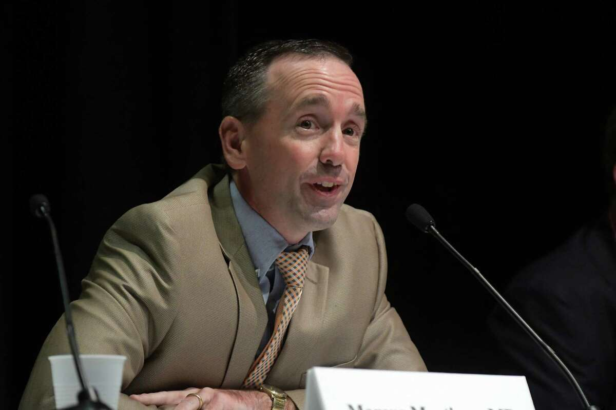 Doctor Marcus Martinez, a Hoosick Falls physician, testifies before the New York State Senate Joint Public Hearing in Hoosick Falls, on Tuesday, Aug. 30, 2016, at Hoosick Falls High School in Hoosick Falls, N.Y. The hearing was held to hear from people about the water contamination in and around Hoosick Falls. (Paul Buckowski / Times Union)