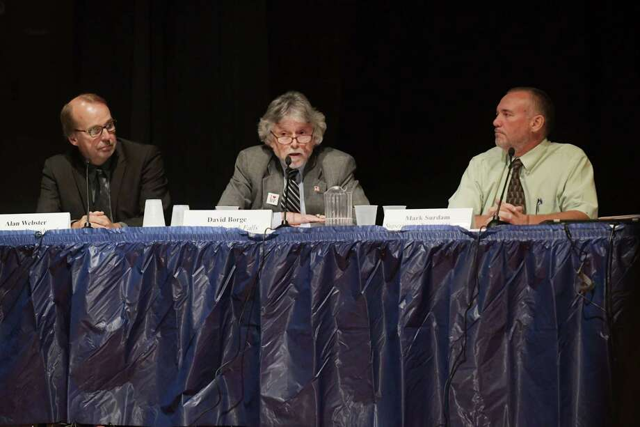Alan Webster, left, supervisor of the Town of Petersburgh, David Borge, center, Mayor of the Village of Hoosick Falls and Mark Surdam, the supervisor of the Town of Hoosick, testify before the New York State Senate Joint Public Hearing in Hoosick Falls, on Tuesday, Aug. 30, 2016, at Hoosick Falls High School in Hoosick Falls, N.Y.  The hearing was held to hear from people about the water contamination in and around Hoosick Falls.  (Paul Buckowski / Times Union) Photo: PAUL BUCKOWSKI / 20037806A