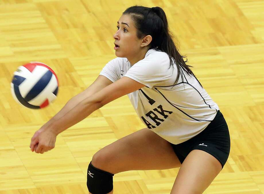 Clark's Libero, Mia Ybarra grabs a serve as Clark plays Brennan in volleyball at Taylor Field House on August 30, 2016 Photo: TOM REEL, STAFF / SAN ANTONIO EXPRESS-NEWS / 2016 SAN ANTONIO EXPRESS-NEWS