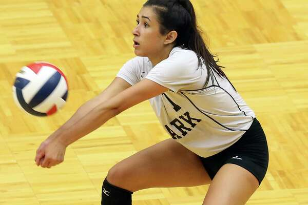 Clark's Libero, Mia Ybarra grabs a serve as Clark plays Brennan in volleyball at Taylor Field House on August 30, 2016